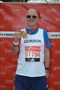 Gordon proudly displaying his medal